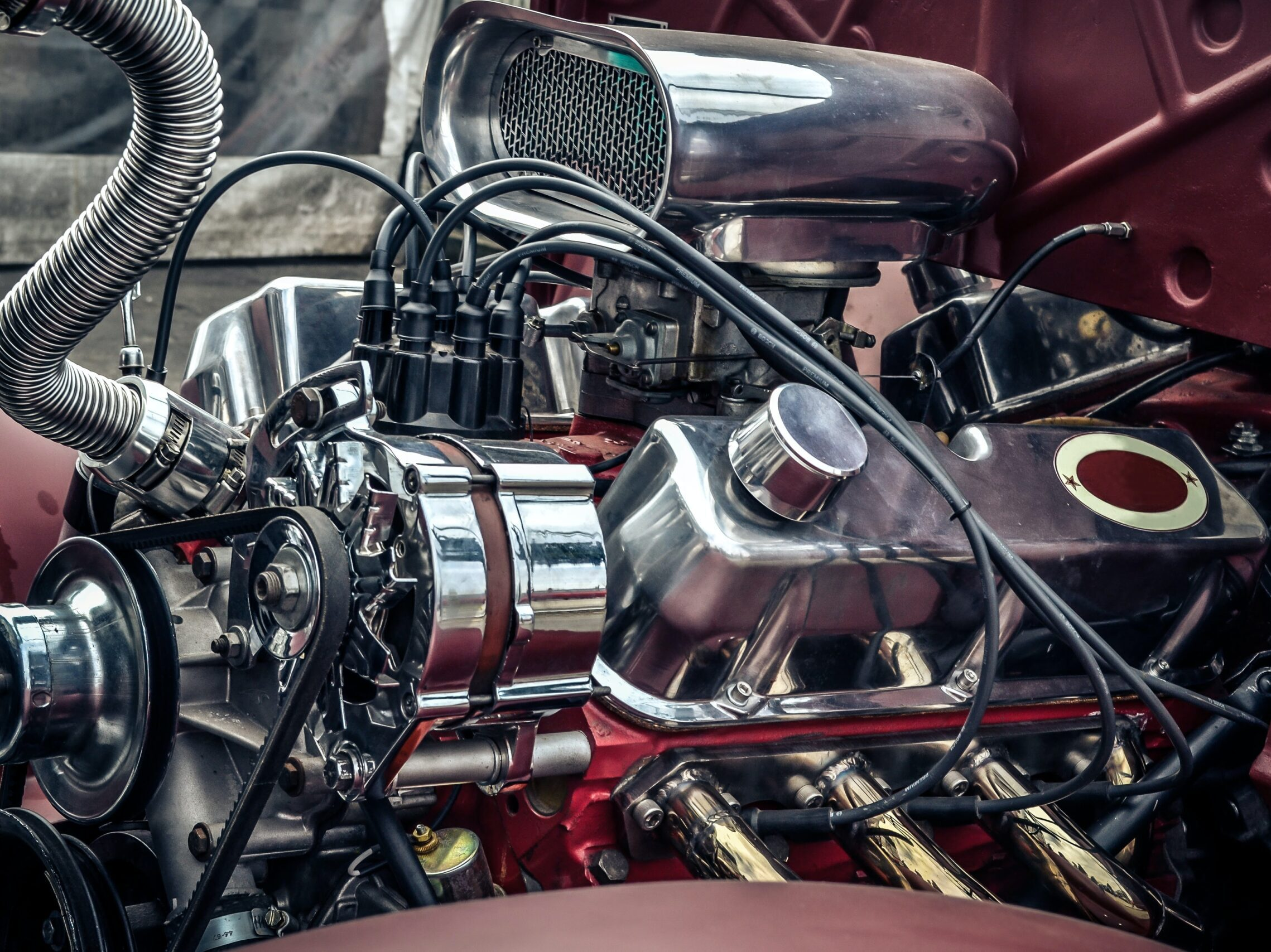 red and silver motorcycle engine