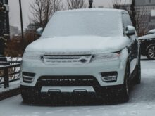 snow covered Land Rover Range Rover SUV