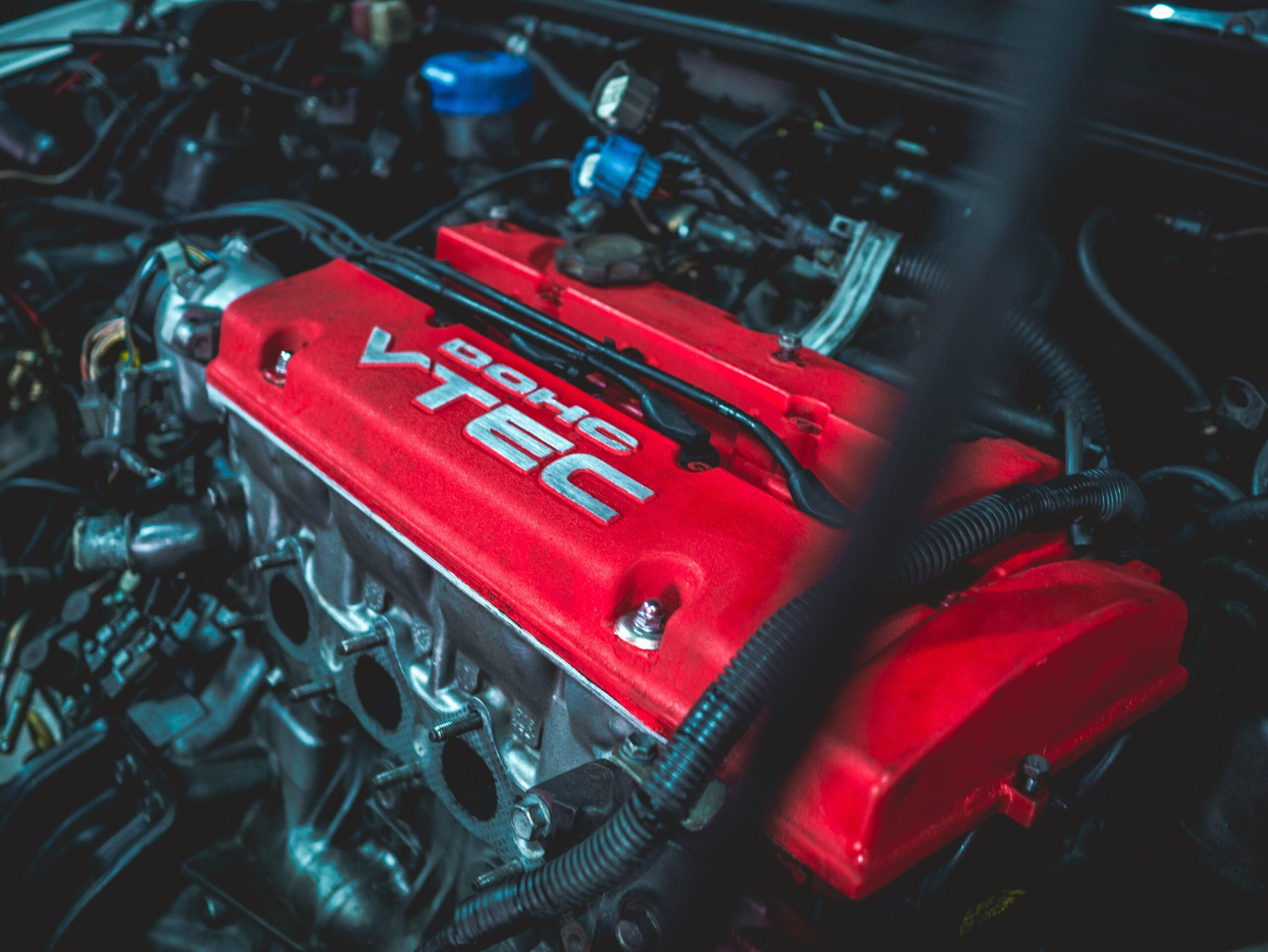 red and black car engine
